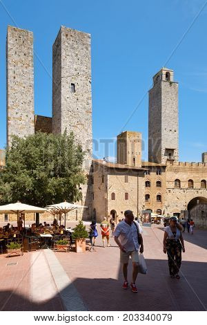 SAN GIMIGNANO,ITALY - JULY 23,2017 : Tourists  at the medieval hill town of San Gimignano in Tuscany
