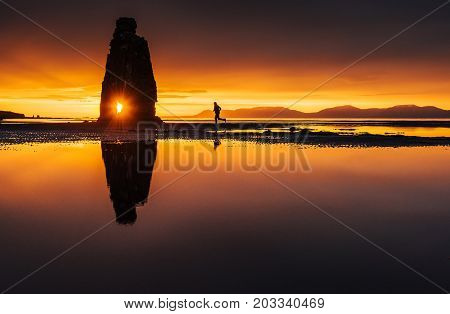 Hvitserkur 15 m height. Is a spectacular rock in the sea on the Northern coast of Iceland. On this photo Hvitserkur reflects in the sea water after the midnight sunset