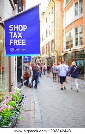 Stockholm, Sweden - July 25, 2017: Shop Tax Free sign on main shopping street of Gamla Stan in Stockholm