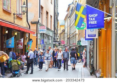 Stockholm, Sweden - July 25, 2017: Tourists in central shopping street of Gamla Stan in Stockholm