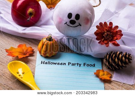 Halloween Party Food concept on notebook and wooden board