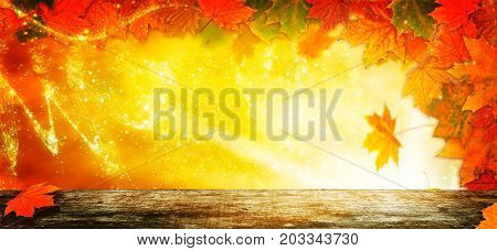 Autumn background Golden Autumn behind wooden table