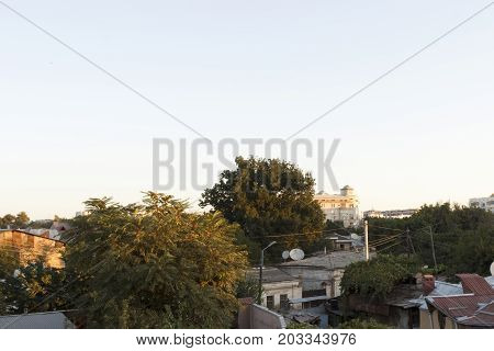City slums smoothly pass into a modern city.