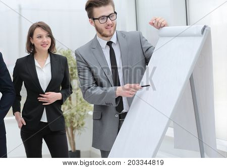 businessman pointing pen on blank Board for presentation