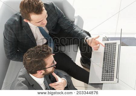 employees working with a laptop