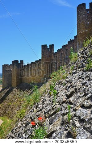 The fortress wall of the castle in the Convent of Christ former Roman Catholic monastery in Tomar Portugal. The convent was founded by the Order of Poor Knights of the Temple (or Templar Knights) in 1118