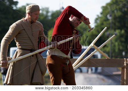 ST. PETERSBURG, RUSSIA - JULY 9, 2017: Participants preparing a lance for jousting tournament during the military history project Battle On Neva at St. Peter and Paul fortress. It's the 4th such event