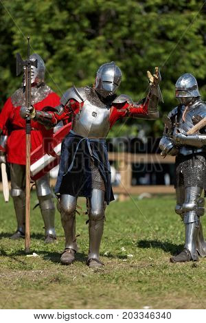 ST. PETERSBURG, RUSSIA - JULY 9, 2017: Armored knights preparing to the tournament during the military history project Battle On Neva at St. Peter and Paul fortress. It's the 4th such an event