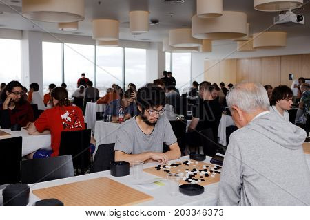 ST. PETERSBURG, RUSSIA - AUGUST 6, 2016: Participants of European Go Congress play in the playing hall. 1176 people from 48 countries are registered in this 60th Congress