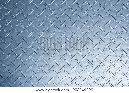 The metal texture background in light blue scene.Th texture at the metal plat for anti-slip reason