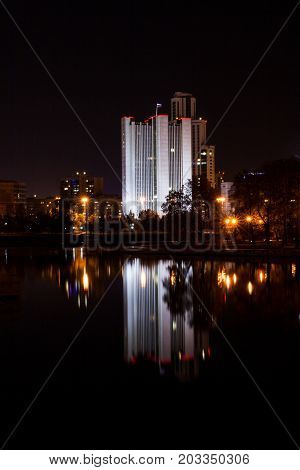Government house and its reflection in the water of the city pond in the evening. The government building called the White house. Ekaterinburg is the largest city of the Ural with population of about 1.5 million.
