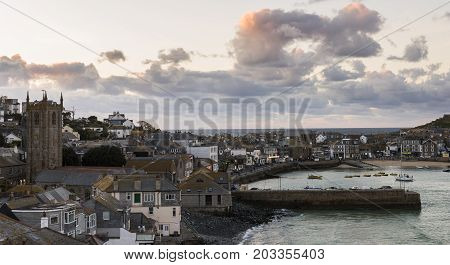 Saint Ives England - April 29 2017: Harbor city and church with beach of Saint Ives in Cornwall England.