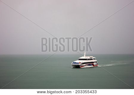 Speed boat sailing in fog rainTravel and transportation In the rainy season and the monsoon in Thailand