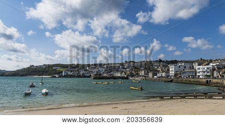 Saint Ives England - April 29 2017: Harbor with beach of Saint Ives in Cornwall England.