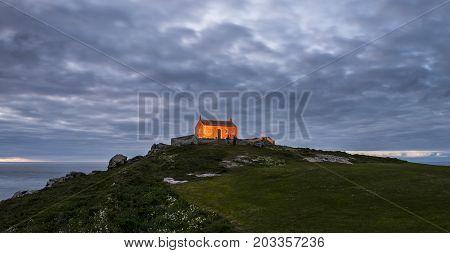 Saint Ives England - April 28 2017: Saint Nicholas Chapel in Saint Ives during sunset.