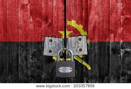 Angola flag on door with padlock close