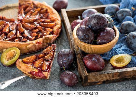 Homemade plum pie autumn dessert with fresh plums baking healthy vegetarian food