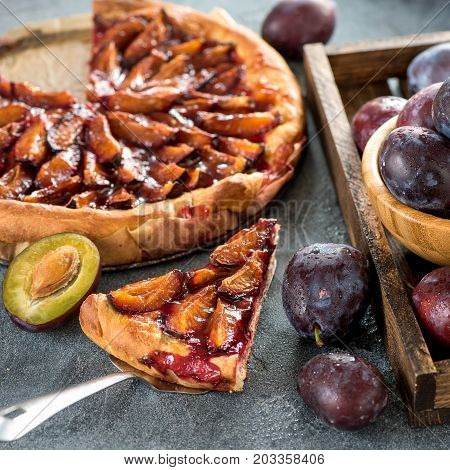 Homemade plum pie autumn dessert with fresh plums baking healthy vegetarian food square image