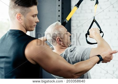 Sportsman Training With Trx And Trainer