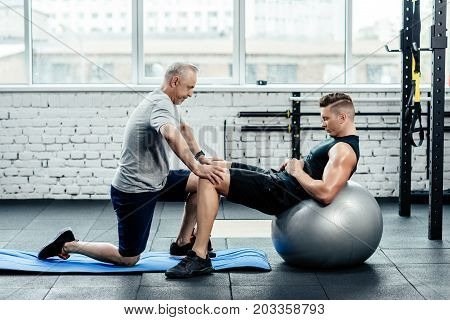 Sportsman Doing Abs On Fitness Ball