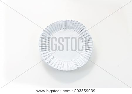 Hand made white porcelain plate with fluted rim, isolated on white, horizontal view