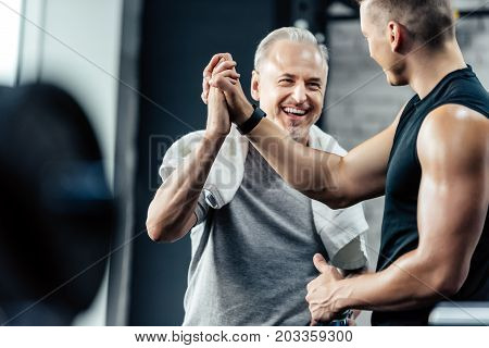 Sportsman Giving Highfive To Trainer