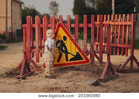 photo of little boy on the repaired road