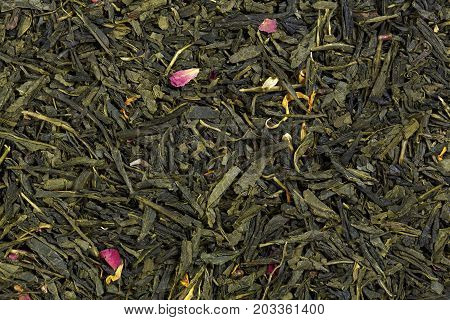 Mix green tea with petals of marigold and rose petals. High quality texture on macro.
