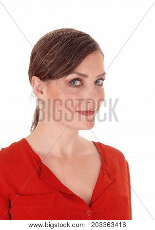 A portrait image of a beautiful young woman standing in a red blouse with her hair back isolated for white background