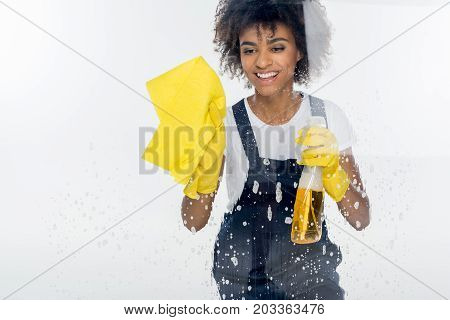 African American Cleaner Cleaning Window