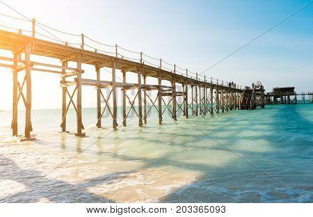 Local primitive bridge on zanzibar, tanzania, standing in the ocean, calm waters