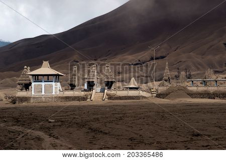 Hindu Temple Pura Luhur Poten at the foot of the active Volcano Bromo in the afternoon at the Tengger Semeru National Park in East Java Indonesia.