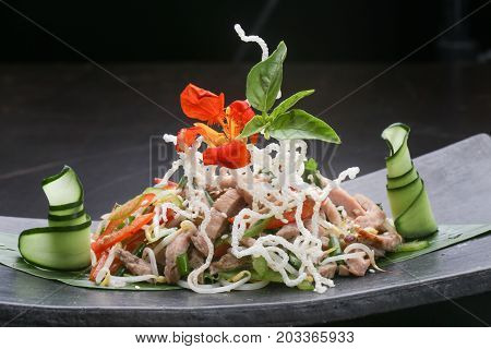 Rice noodles served with meat and veggie