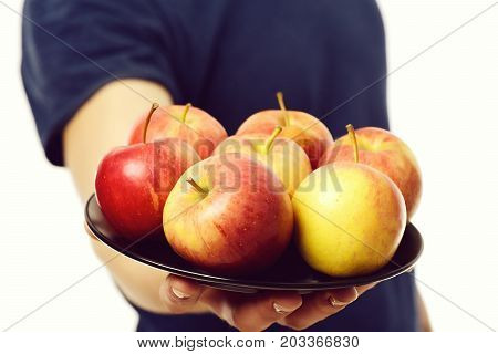 Plate Of Red And Yellow Apples On Males Hand