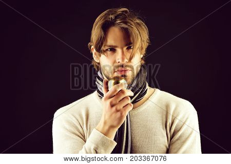 Man With Beard And Attentive Look Holds Golden Apple