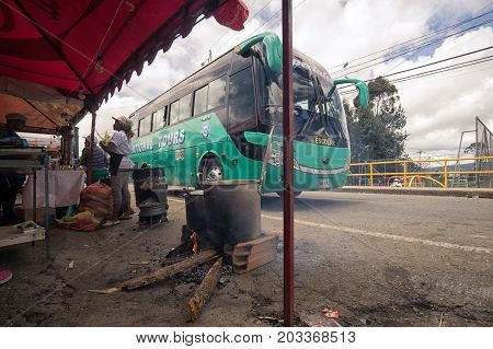 August 6 2017 Medellin Colombia: food is getting prepared beside the road on a wood fire during the long weekend flower festival fiesta