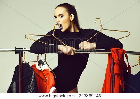Pretty Girl With Blue Lips Posing At Clothing Rack