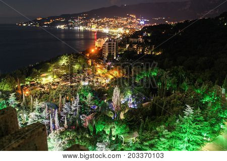 Night illumination of Yalta coast. Night surroundings and adjoining territories of hotel Yalta Intourist.