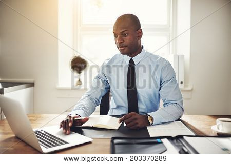 Focused Young Businessman Working At His Office Desk