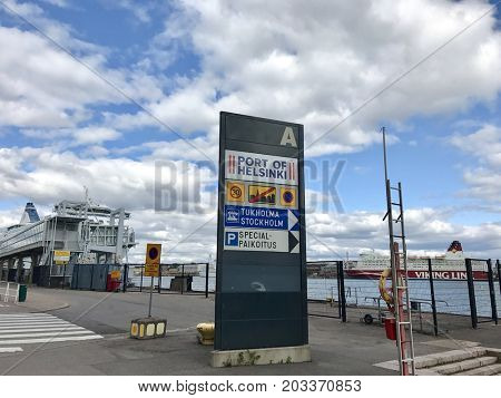 HELSINKI - SEPTEMBER 6, 2017: Entrance sign and cruise ships at the Port of Helsinki, Finland.
