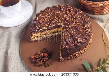 Chocolate Layered Cake With Nougat And Sponge Cake In The Cut On The Plate