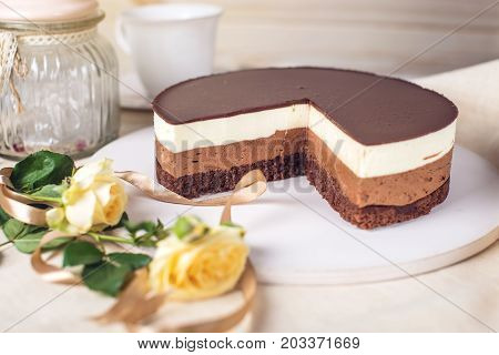 Chocolate Cake Made Of Three Different Chocolate Mousse Layers , White , Milk And Dark With Chocolat