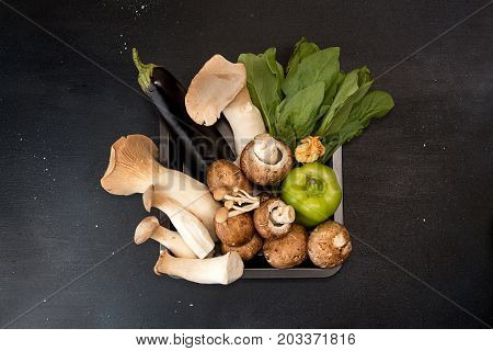 Oyster Mushrooms King Mushrooms And Vegetables On Dark Background. Oyster Mushrooms King Mushrooms E