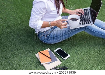 Workspace relaxing chill out work for office and design laptop smartphone with morning coffee select focus