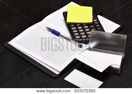 Office Tools Isolated On Black Wooden Background, Close Up