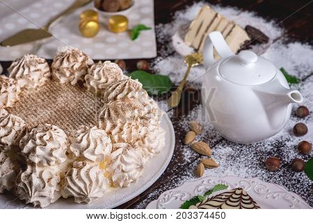 Beautifully Decorated Dessert Table Where The Cake With Meringue On A Dark Wooden Table. Arrangement