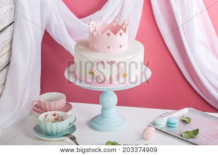Cute Pink Cake With A Crown On The Table To The Birthday For A Princess