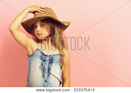 Kid With Interested Face And Long Hair Wears Jeans Dress