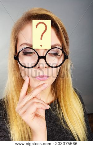 Woman Having Question Mark On Forehead Thinking