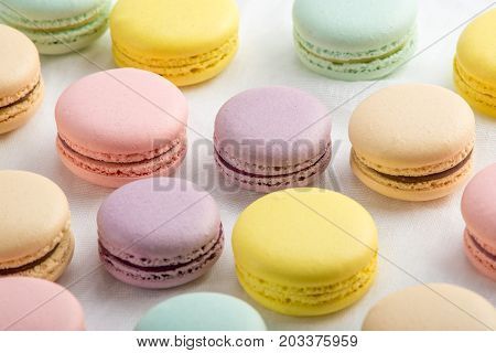 Colorful Macarons On A White Background. French Dessert